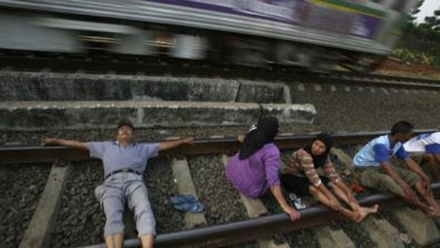 Desperate Indonesians Turn to Train Track Therapy