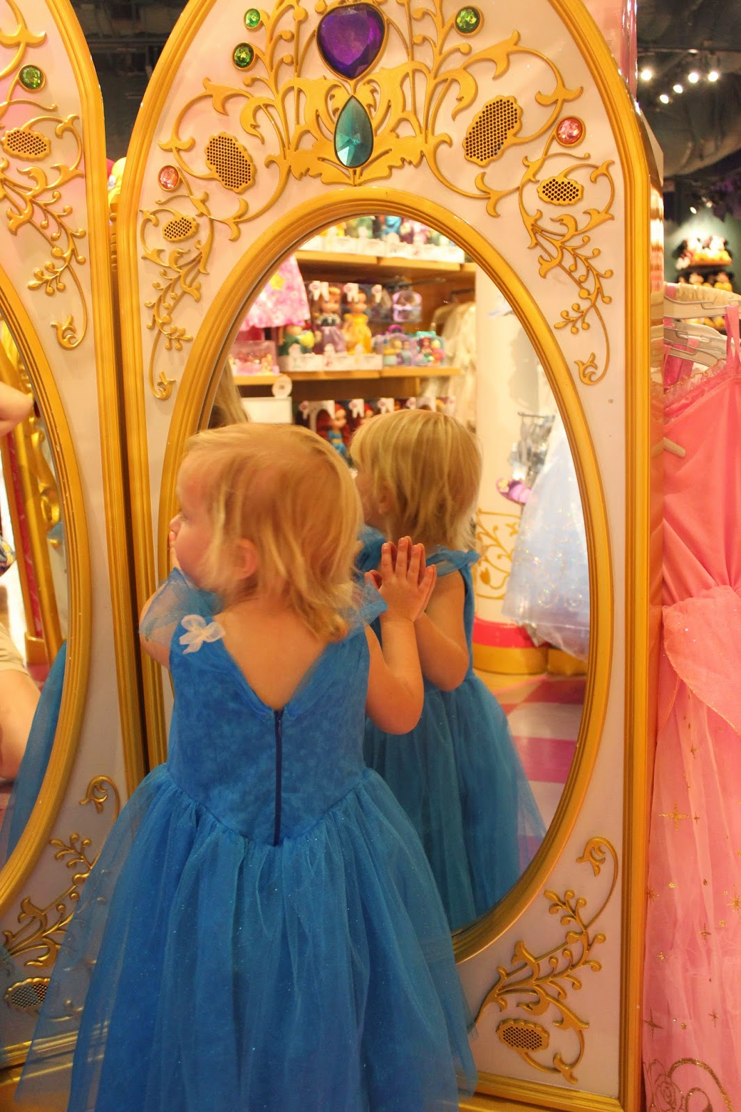 Little girl in blue princess party dress