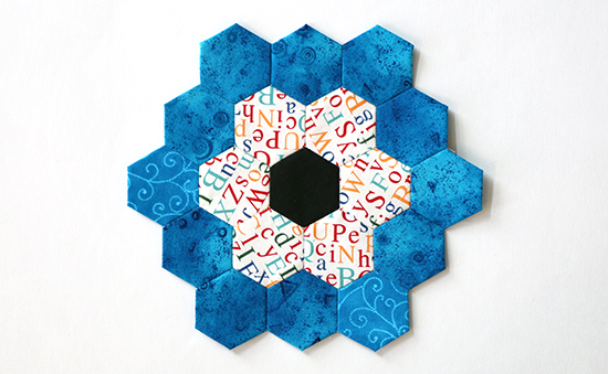 EPP Hexagon Flower Block 17 with Blue Print and Colorful Letters on White