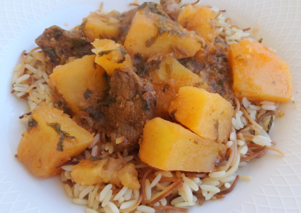 Potato stew With meat over rice in a dish