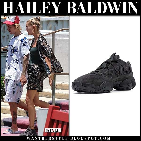 Hailey Baldwin with Justin in floral shorts and black sneakers yeezy model style july 14