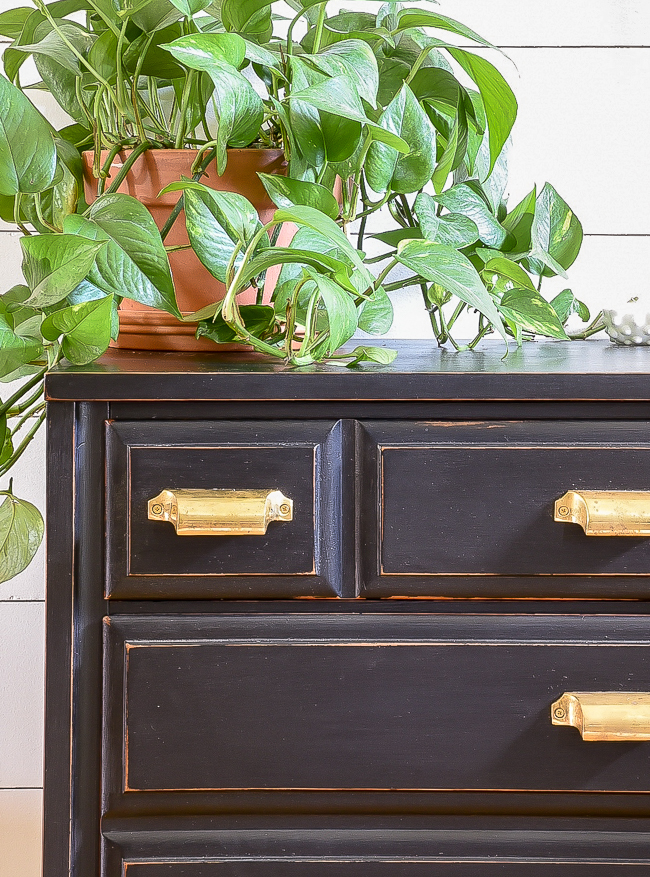 Distressed black dresser with brass bin pulls