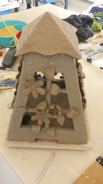 Pottery lantern with clematis design in progress by Lily L.