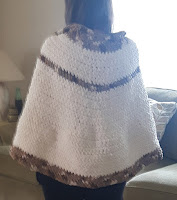 The back view of a crocheted pull-over poncho made without having a pattern.