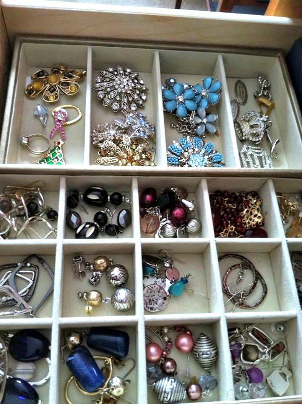 Organizing jewelry with compartment boxes that fit in your dresser drawer from Walking on Sunsine