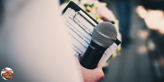 "Featured in the article: ""How To Become A Motivational Speaker"". Motivational speaker training, notebook, microphone, preparation before speaking in public"
