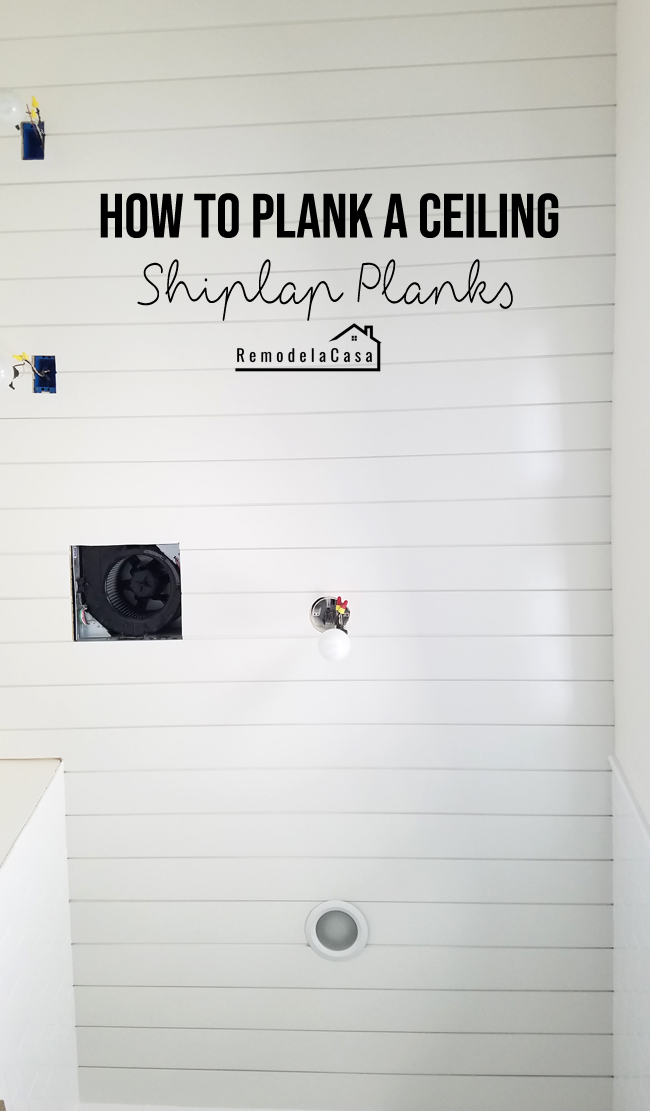 bathroom ceiling covered with pine painted shiplap boards