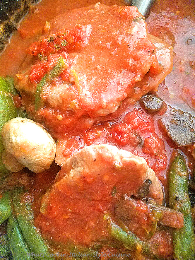 Italian sauce steak is inexpensive cuts of meat like cube or in the photo round steak with crushed tomatoes simmered in a pan with button mushrooms and peppers until fork tender