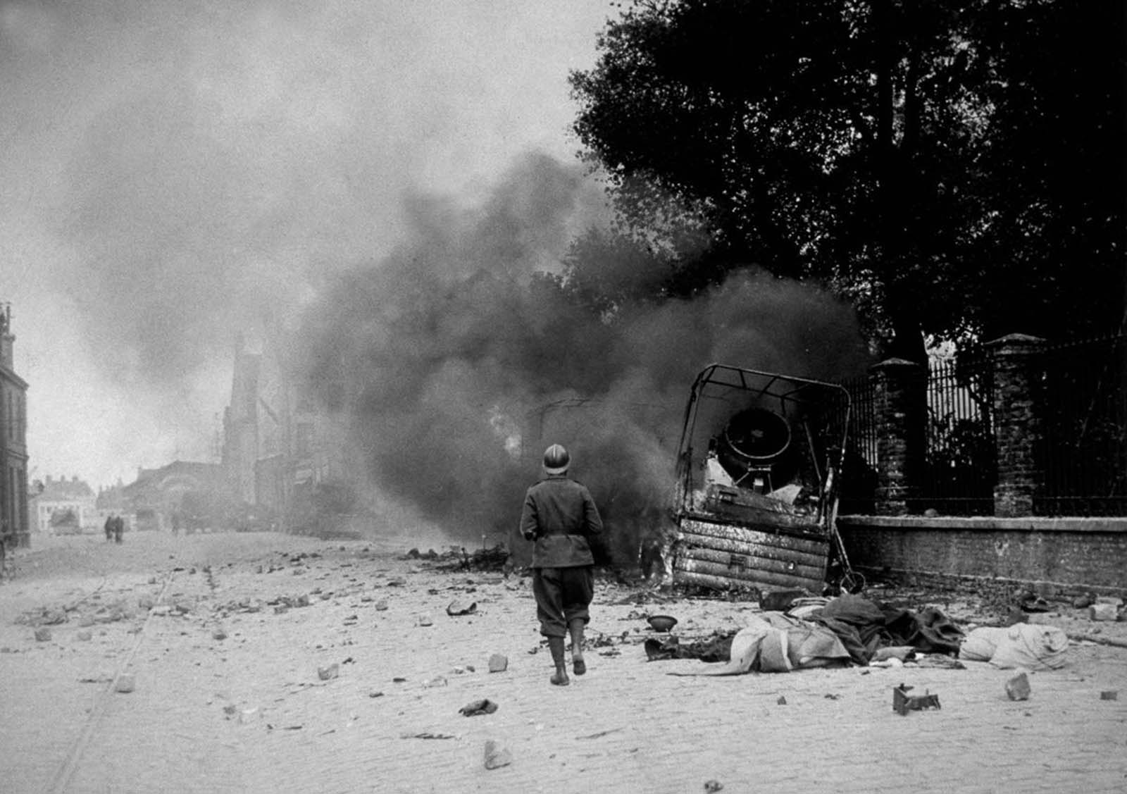 The town of Dunkirk while under bombardment.