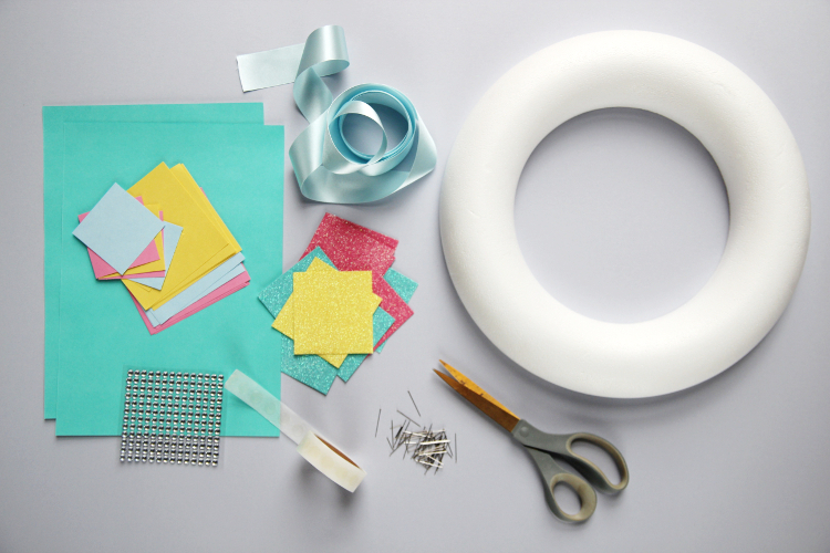 Materials needed to make a Diy Spring Paper Flower Wreath.