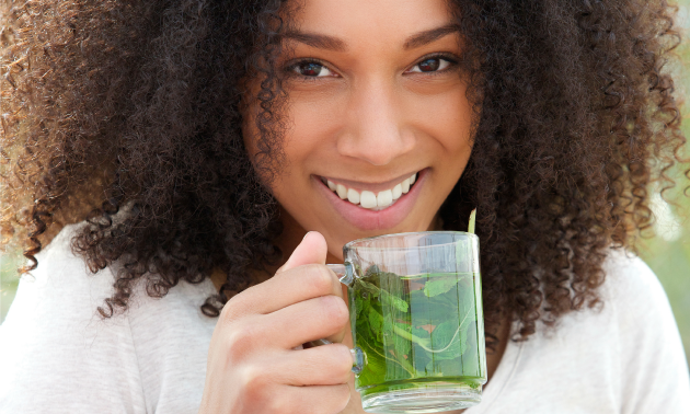 Woman drinking slimming tea for weight loss