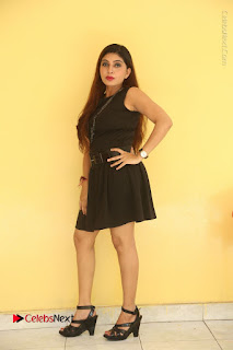 Tollywood Upcoming Actress Pooja Roshan Stills in Black Short Dress at Plus 1 Movie Trailer Launch  0239.JPG