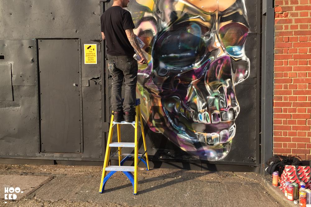 Artist Fanakapan at work, Street Art Skull Mural in East London. Photo ©Mark Rigney / Hookedblog