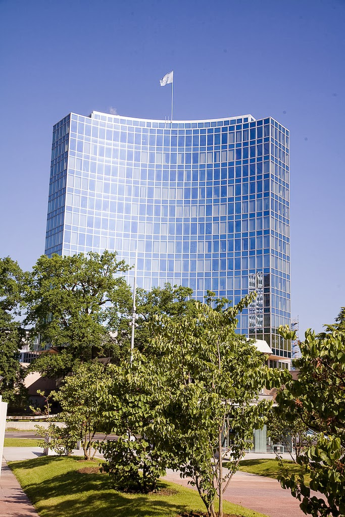A tall modern building flying a UN flag