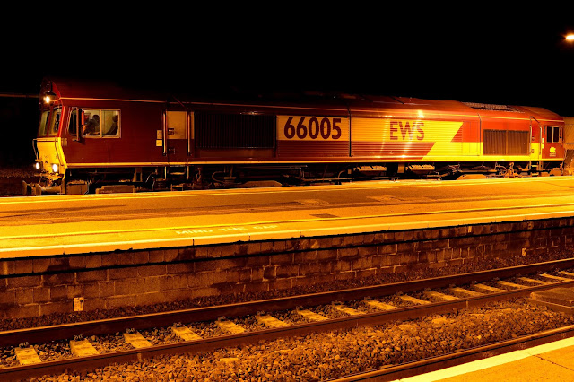 Night photo of Diesel Locomotive Class 66005 in EWS livery waits for the all-clear on the freight line at Wellingborough station in 2016