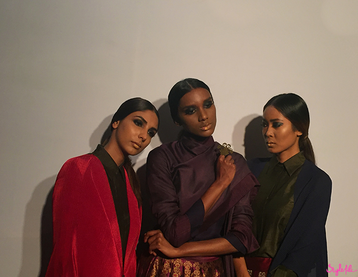 Models wear smokey eyes, gold lips and slicked back hair for designer Payal Khandwala at Lakme Fashion Week in Mumbai India
