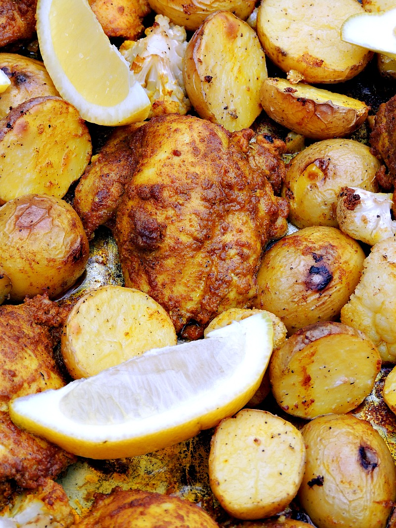 Close up of Sheet Pan Chicken Shawarma with lemon wedge