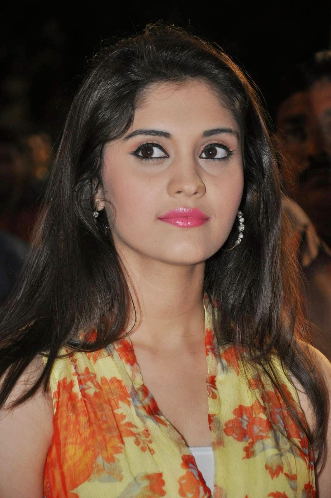 Surabhi Photos At Audio launch In Yellow Dress