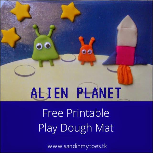 A free printable play dough mat to make an alien planet scene.