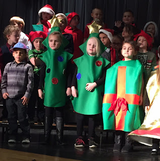 Students standing singing for Christmas Program