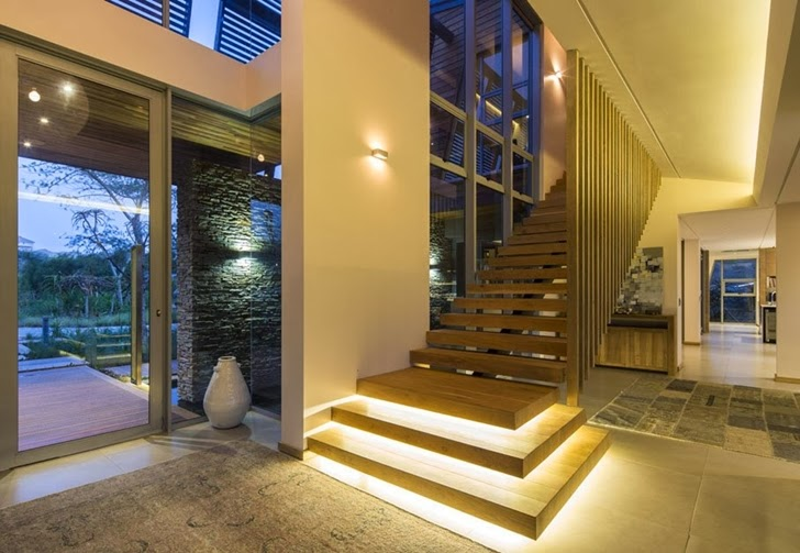 Wooden stairs in Modern Mansion by Metropole Architects