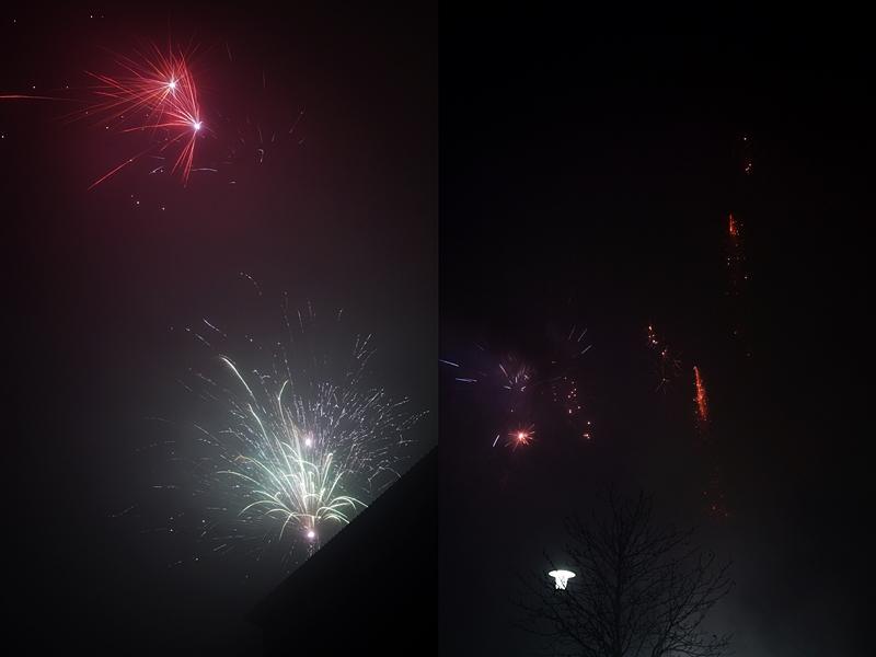 Buntes Feuerwerk im Himmel an Silvester und dunkle Straßen
