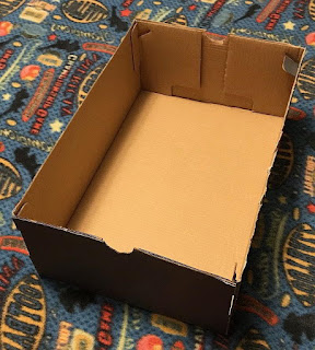 Shoe box with top cut off. Not pretty