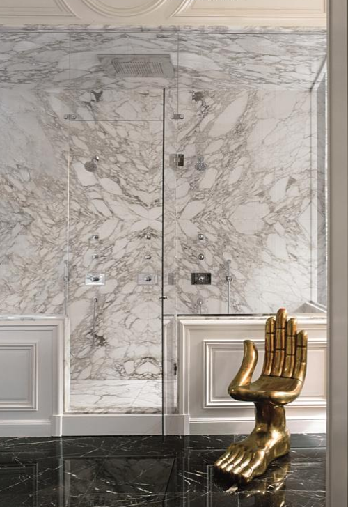 Every home should have white marble bathrooms with brass