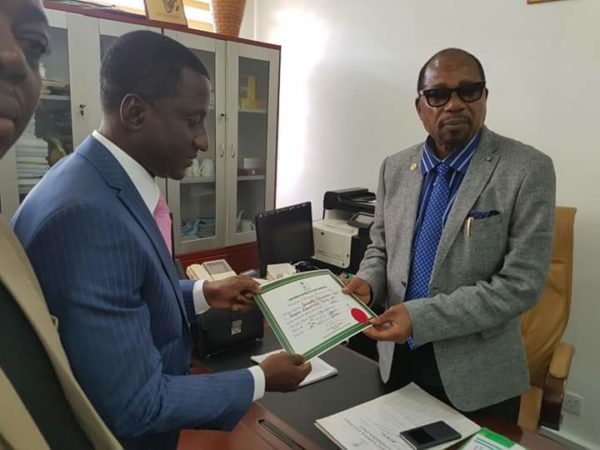 Uche-Ogar-receiving-his-Certificate-of-Return-from-NEC