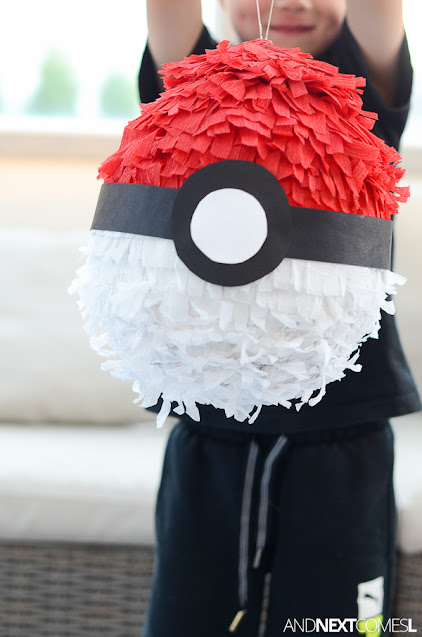 Holding up a finished Pokemon pinata