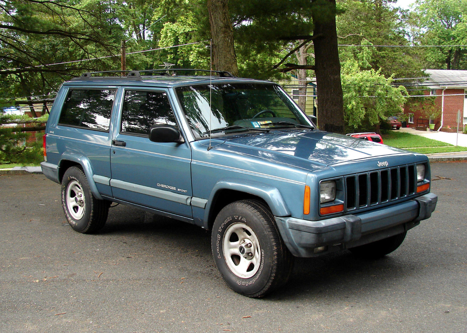 daily turismo auction watch 1999 jeep cherokee sport xj. Black Bedroom Furniture Sets. Home Design Ideas