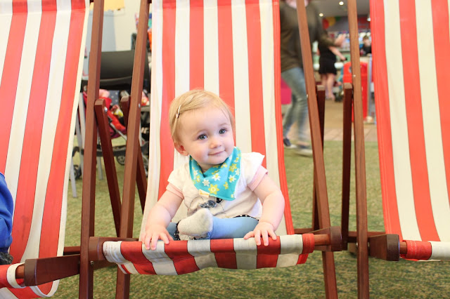 baby sat in red and white striped deck chair in butlins skyline pavilion