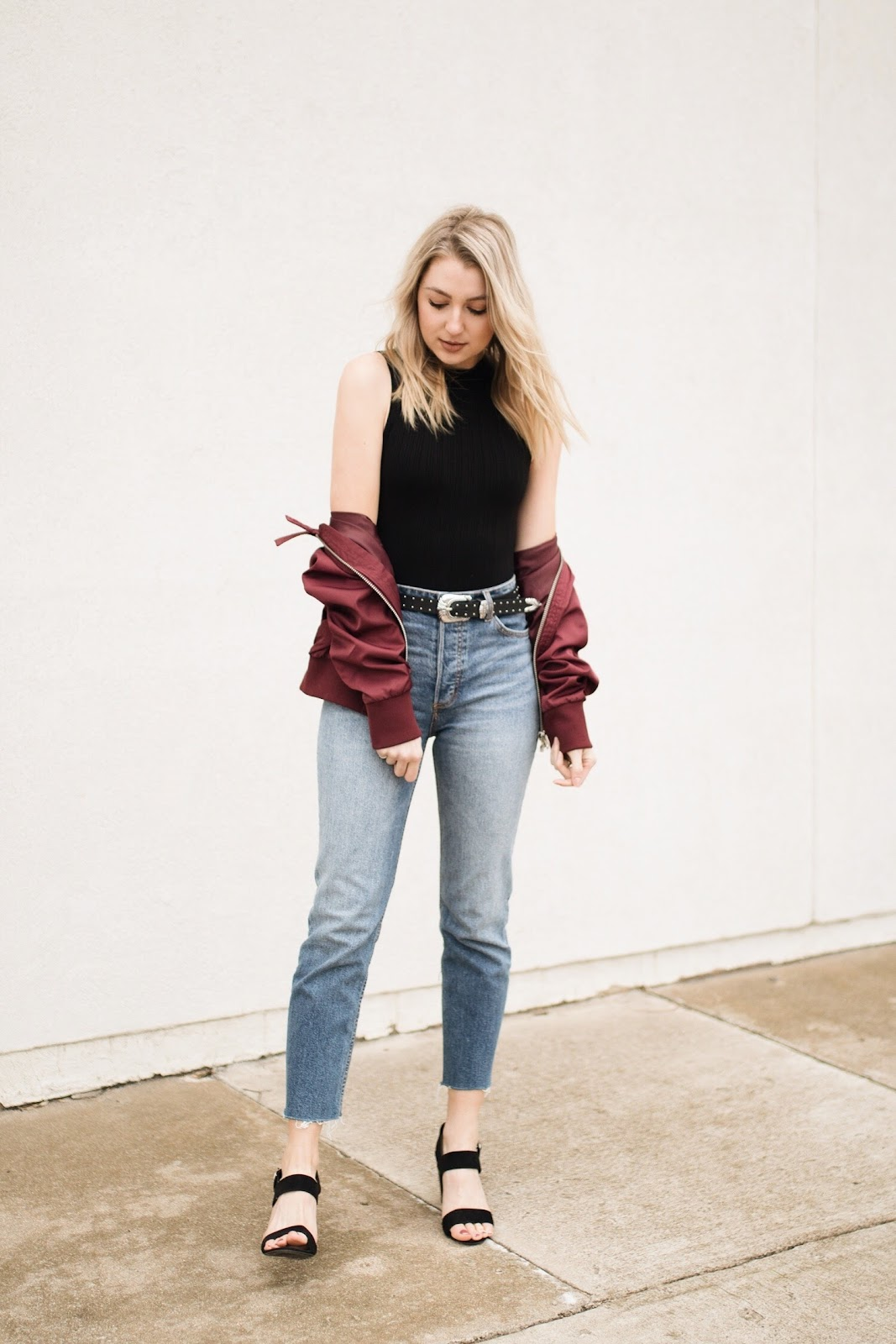 High-waisted relaxed jeans, bodysuit, bomber jacket