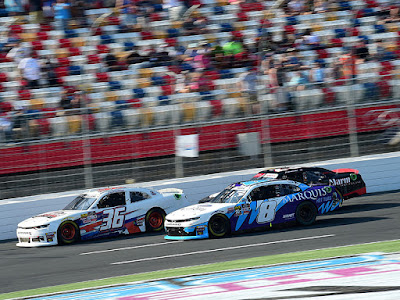 Josh Williams, Ryan Truex and John Hunter Nemechek race for position during Stage 2 of the NASCAR Xfinity Series Drive for the Cure 250 presented by Blue Cross Blue Shield of North Carolina at Charlotte Motor Speedway.