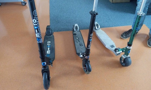A range of Micro scooters and the new emicro one