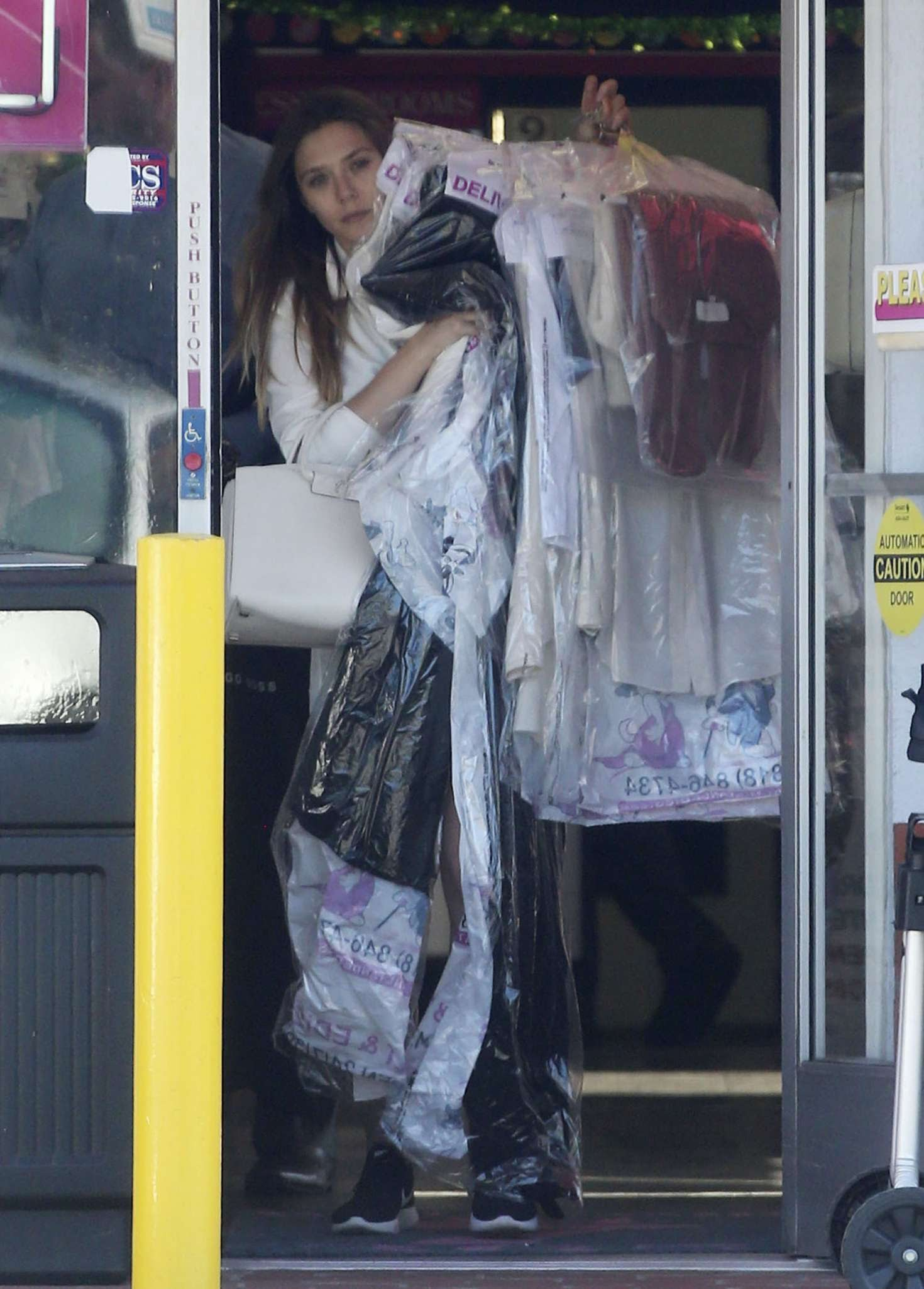 Elizabeth Olsen brought lots of clothes finished from the cleaning shop