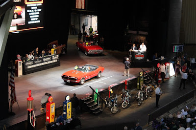 Auctioneer sells vehicles at the 2018 Saratoga Auto Auction