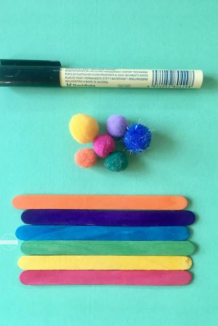 colored-popsicle-sticks-pom-poms-sharpie