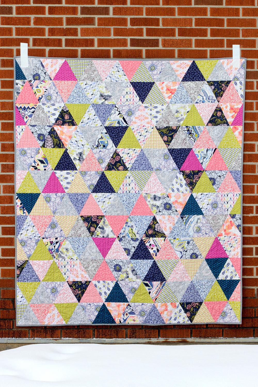 http://www.jenibakerpatterns.com/product/triangularity-quilt-pdf-pattern