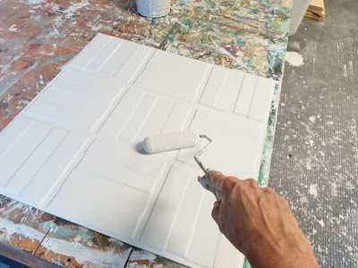 painting textured wall panels before installation