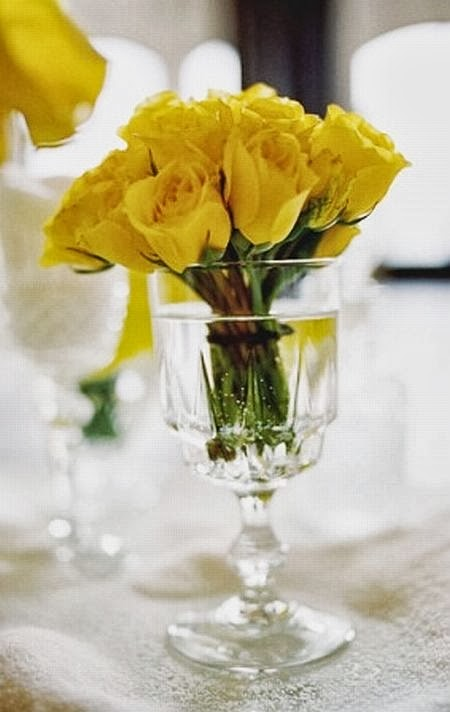 beautiful yellow roses in a glass