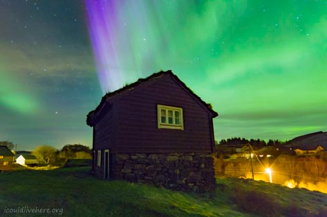 Northern lights above an old house in Norway
