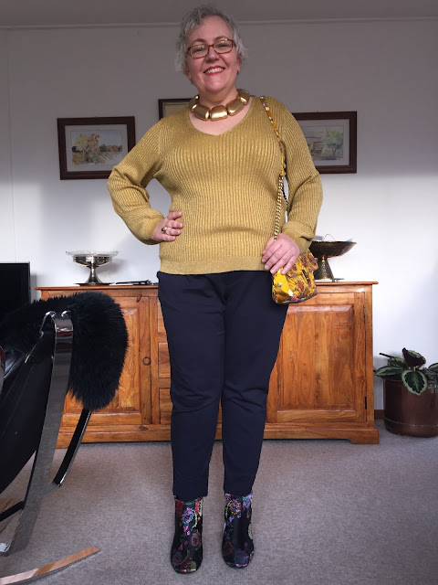 Kaffesoester in navy trousers mustard shimmer knit and brocade boots