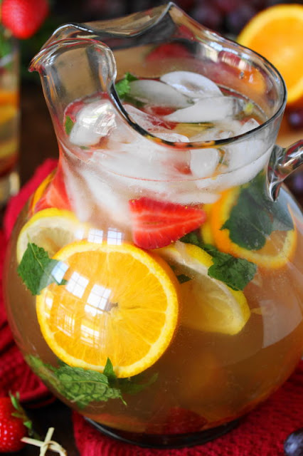 Looking for a special beverage treat for your little ones?  Give Virgin White Sangria a try!  It's a tasty, beautiful, no-alcohol version of sangria perfect to make those kiddos feel extra special.  And hey, the grown-ups will love it, too.