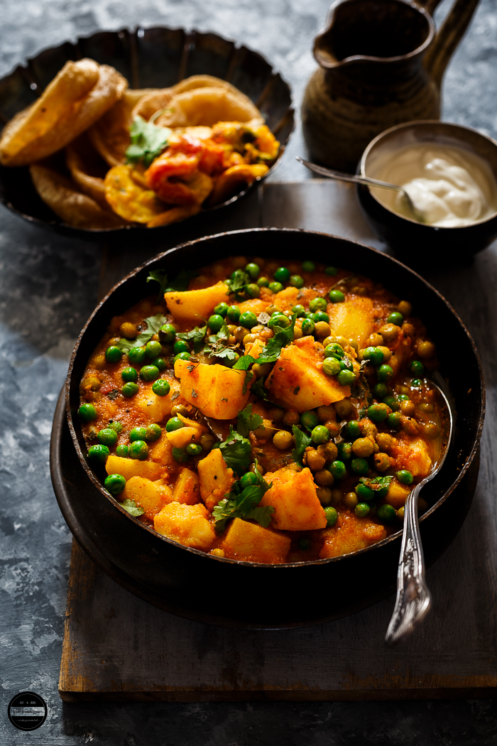Aloo Matar-No Onion Garlic curry is a healthy, quick and simple to make. This delicious curry prepared with humble vegetables such as potato, green peas and tomato. Easy healthy side dish which is perfect with roti or puri.