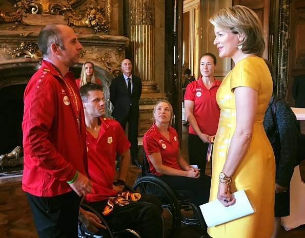 Queen Mathilde held a reception at the Royal Palace to congratulate the athletes that won medals. Mathilde wore a yellow dress by Natan fashion hause