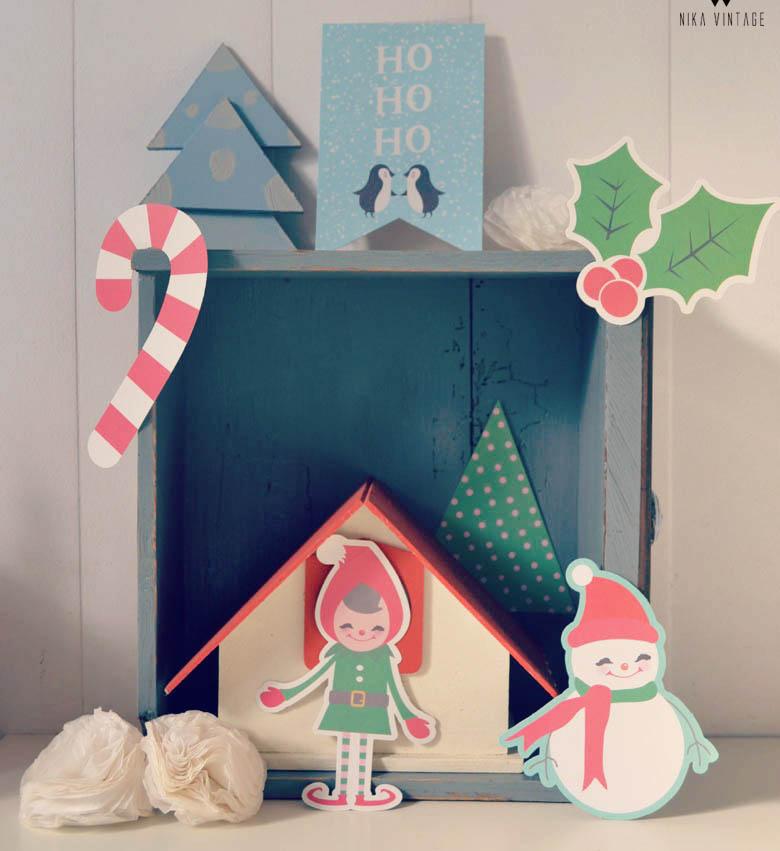 Decoración de navidad original y divertida con ciervos en fanales, letras y cajones de madera