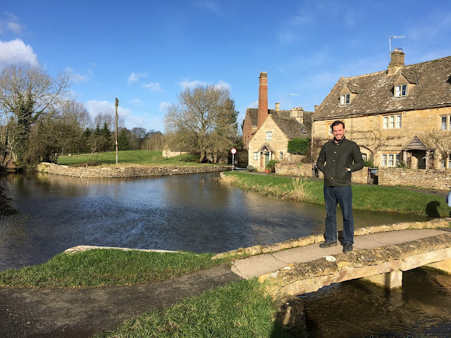 Simon stood on the little stone bridge which leads to the Old Mill House - Lower Slaughter, Cotswolds