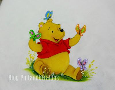 manta com pintura do ursinho pooh e borboletas