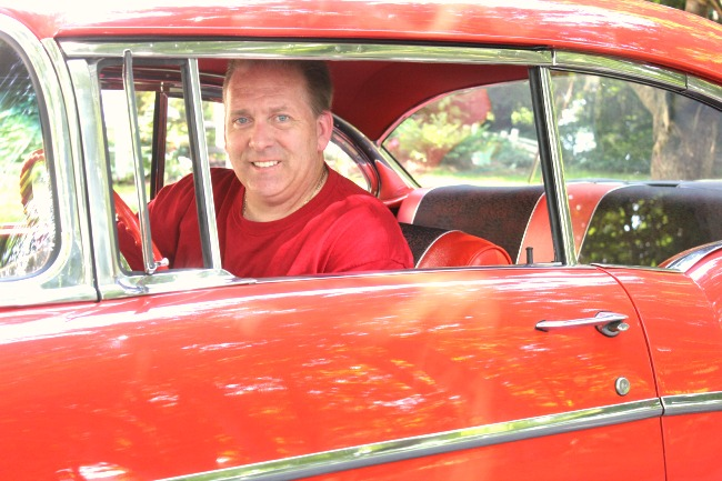 Mike in the red Chevy Bel Air he restored